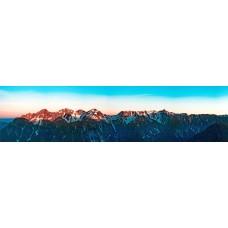 Bergtoppen in de zon - panoramische fotoprint